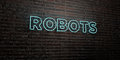 ROBOTS -Realistic Neon Sign on Brick Wall background - 3D rendered royalty free stock image