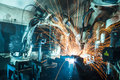 Robots welding in a car factory movement Royalty Free Stock Photo