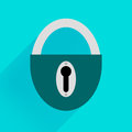 Robust dark green padlock on a blue background Royalty Free Stock Photo