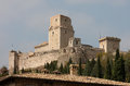 Rocca maggiore medieval castle assisi is an imposing bastion that looms over the hill town in umbria intimidating potential Royalty Free Stock Photography