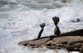 Rock balancing art on beach rocks in Laguna Beach, California. Royalty Free Stock Photo