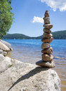Rock balancing at a lake Royalty Free Stock Photo