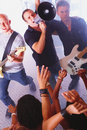 Rock band shouting at young audience Royalty Free Stock Photos
