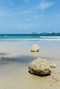 Rock on beach blue sky background photo stock Stock Photos