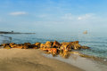 Rock beach on sea background Royalty Free Stock Photo