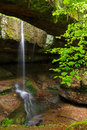Rock bridge in ohio s hocking hills the rockbridge is a geological formation county a small waterfall plunges between the hillside Stock Images