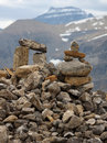 Rock cairns inuksuk on mountain trail on rainy day parker ridge icefields parkway near jasper national park Stock Images