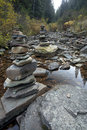 Rock cairns in the stream. Stock Photos