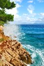 Rock Cliff Blue Sea Waves Royalty Free Stock Photos