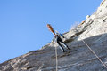 A rock climber abseiling off a climb european alps Royalty Free Stock Image