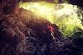 Rock climber climbing at mountain cliff