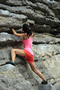 Rock climber climbing at seaside mountain cliff Royalty Free Stock Photo