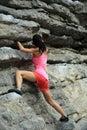 Rock climber climbing at seaside mountain cliff Royalty Free Stock Photo