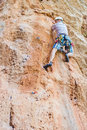 Rock climber climbing up a cliff turkey Stock Image