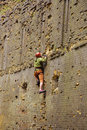 Rock climber climbing up male on a wall Royalty Free Stock Photo