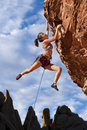 Rock climber dangling. Royalty Free Stock Images
