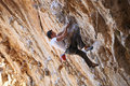 Rock climber on a face of a cliff Royalty Free Stock Photos