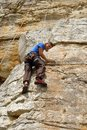 Rock climber looks down Royalty Free Stock Photo