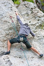 Rock climber man on wall young athletic during outdoor climbing with special equipment ensurig safety Stock Image