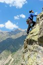 The rock climber during rock conquest going to summit Royalty Free Stock Photo