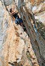 The rock climber during rock conquest going to summit Royalty Free Stock Photography