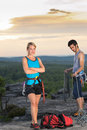 Rock climbing active people on top sunset Royalty Free Stock Photo