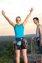 Rock climbing cheerful alpiners on top sunset Royalty Free Stock Photo