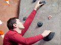 Rock climbing handsome young man indoors Stock Image