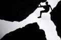 Rock climbing,Man climb between three rock on the cliff. Royalty Free Stock Photo