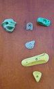 Rock climbing wall with colorful knobs manmade outdoors closeup Royalty Free Stock Image