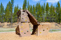 Rock climbing wall at park an outdoor structure a playground a for kids to practice and play on Royalty Free Stock Photography
