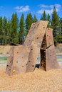 Rock climbing wall at park an outdoor structure a playground a for kids to practice and play on Stock Photos