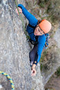 Rock climbing young woman steep granite wall Royalty Free Stock Photo
