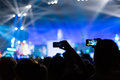 Rock concert photographing with smartphone during a Royalty Free Stock Photos