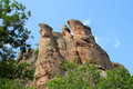 Rock formations in belogradchik bulgaria stone cliff and beautiful stones and unusual surrounded by green trees blue sky with Stock Photos