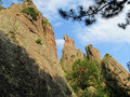 Rock formations in belogradchik bulgaria stone cliff and beautiful stones and unusual surrounded by green trees blue sky with Royalty Free Stock Photography