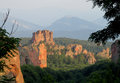 Rock formations in belogradchik bulgaria on sunset stone cliff and beautiful stones and unusual surrounded by green trees blue sky Royalty Free Stock Photography