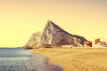 The rock of gibraltar as seen from the beach of la atunara in l at sunset linea de concepcion Stock Photography