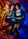 Rock girls fashion portrait of two in glam style lying on colorful background Stock Photo