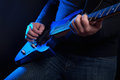 Rock guitarist with blue guitar Royalty Free Stock Photo