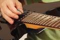 Rock guitarist playing the electric guitar close up Stock Photos