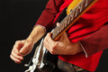 Rock guitarist put fingers for chords on electric guitar on black background Royalty Free Stock Photo