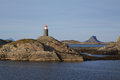 Rock islets with lighthouse on lofoten islands in norway Stock Images