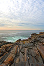 Rock ledges leading to sea at Pemaquid Point, Maine Royalty Free Stock Photo