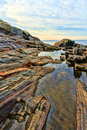 Rock ledges and tidal pools at pemaquid maine view of the very colorful water near the point lighthouse with the atlantic ocean in Stock Image