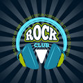 Rock music club, music vector logo, badge, emblem with headphones Royalty Free Stock Photo