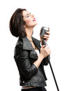 Rock musician keeping mic half length portrait of wearing leather jacket and static isolated on white concept of music and Royalty Free Stock Image