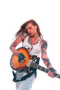 Rock n roll girl with tattoo portrait of young attractive lots of playing electric guitar taken against color background Stock Images