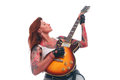 Rock n roll girl with tattoo portrait of young attractive lots of playing electric guitar taken against white background Stock Photography