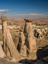 Rock pillars in cappadocia turkey scenic view of a landscape dominated by known as the three beauties near goreme Stock Photos